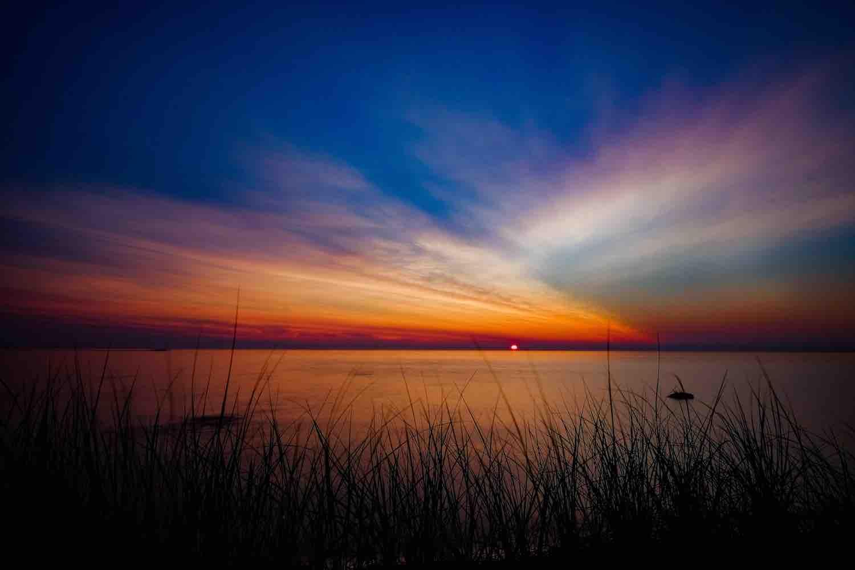 beautiful michigan sunrise photo over lake