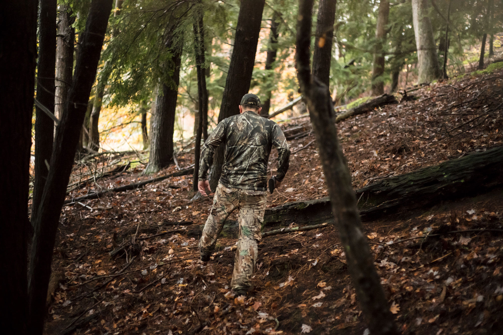 hunter in woods wearing camouflage photography