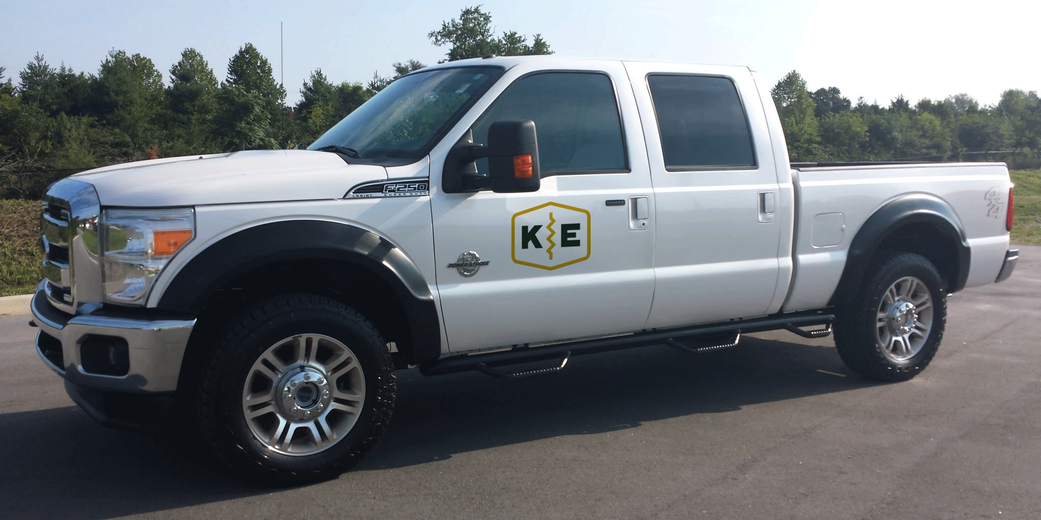 retro badge logo design for kotman electric on white pickup truck