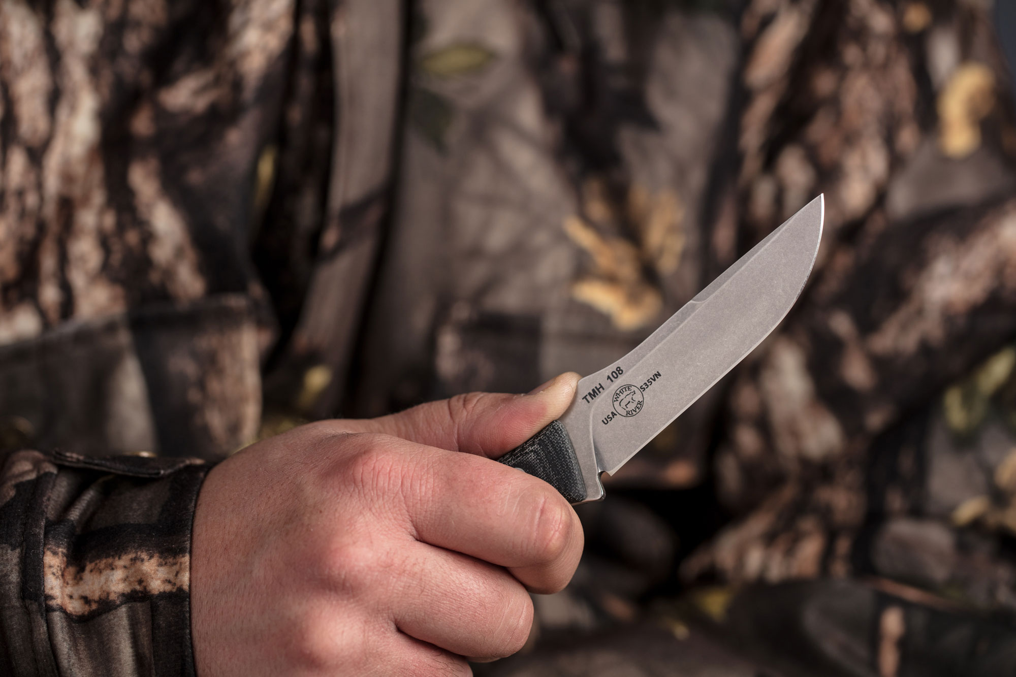 hunting knife photography hunter holding knife