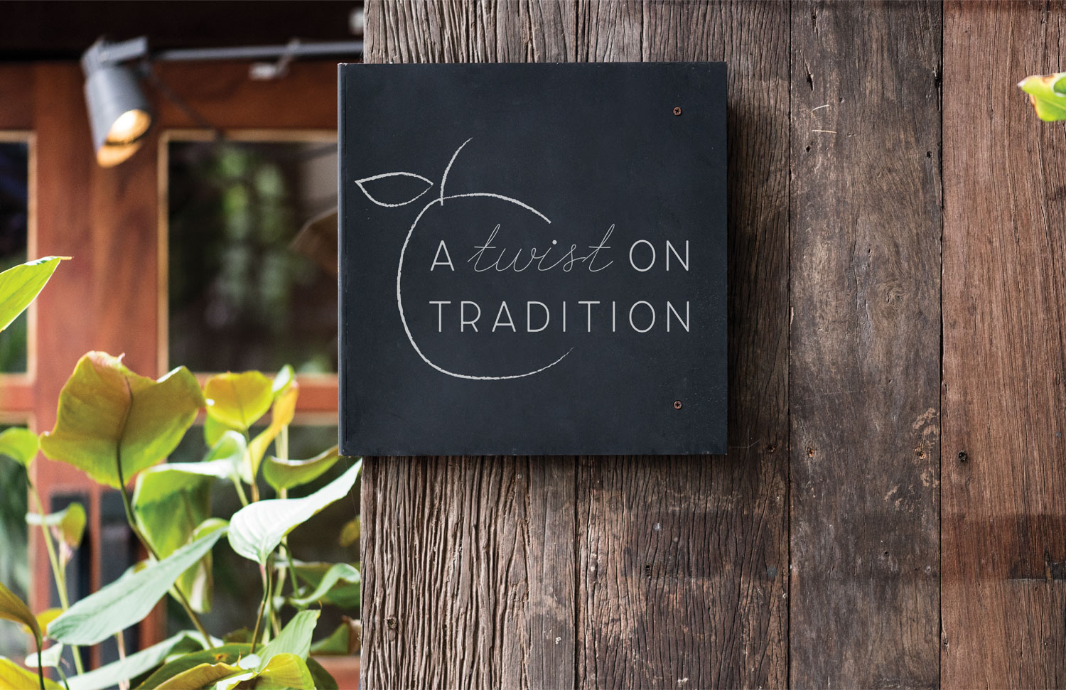 hand drawn apple on black chalkboard sign hanging on wood at farm that says