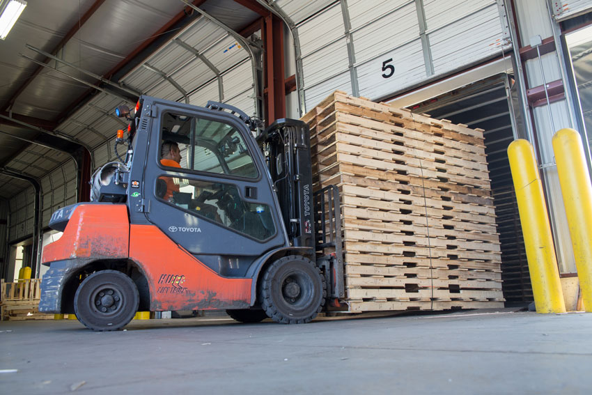 forklift with pallets at lakeland pallets in Grand Rapids, Michigan