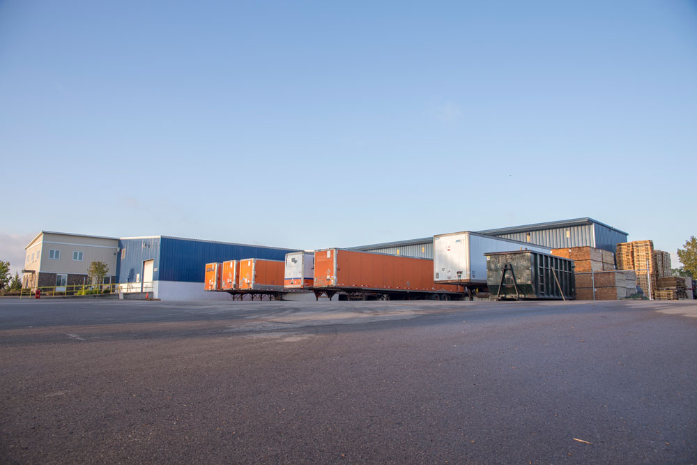 photo of parking lot with trucks and trailers at pallet company in Grand Rapids, Michigan
